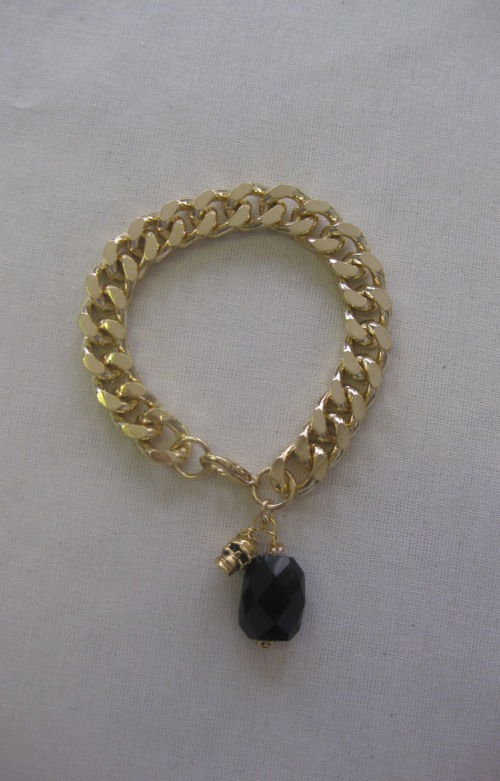 Goldie London Gold Bracelet with black gem and skull